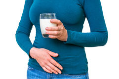 Woman with lactose problem is suffering from stomach pain. On white - dairy intolerance concept Stock Photo