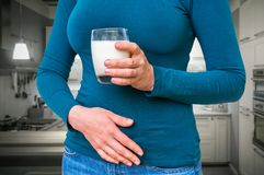 Woman with lactose problem is suffering from stomach pain. Dairy intolerance concept Stock Photos