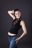 Woman in lacy dress and jeans dance Royalty Free Stock Photos