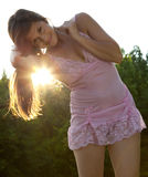 Woman in Lacy Pink Dress With Setting Sun Royalty Free Stock Images