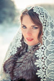 Woman in Lacy tippet in winter. Fairy tale girl in a winter landscape. Christmas. Royalty Free Stock Photography