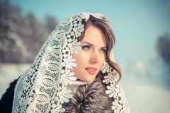 Woman in Lacy tippet in winter. Fairy tale girl in a winter landscape. Christmas. Royalty Free Stock Image