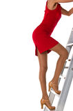 Woman on a ladder Stock Images