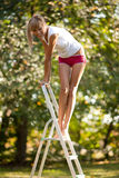 Woman on ladder Royalty Free Stock Photos