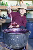 Woman with ladle boiling jam Stock Images