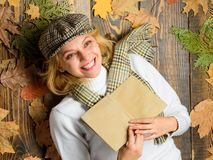 Woman lady in checkered hat and scarf read book. She likes detective genre. Girl in vintage outfit enjoy literature. Fall and autumn season. Girl blonde lay royalty free stock image