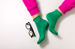 Woman lag with colorful pants and socks Royalty Free Stock Photography