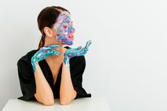 Woman in lagom style and painted hands with face Royalty Free Stock Photography