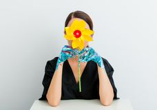 Woman in lagom style and painted hands with pinwheel Royalty Free Stock Images