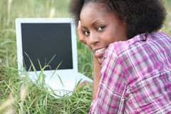 Woman laid in field Stock Photo