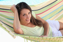 Woman laid in hammock Stock Image