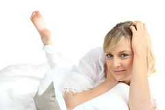 Woman laid on her bed Royalty Free Stock Images