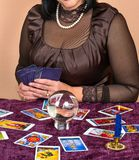 Woman fortune teller. Woman laid on the table the Tarot cards for fortune telling Royalty Free Stock Photography
