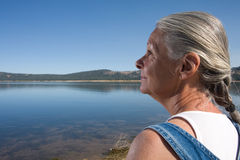 Woman at lake Stock Photos