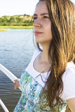 Woman at the lake. Close-up of woman standing lakeside royalty free stock photography