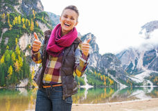 Woman on lake braies showing thumbs up Royalty Free Stock Image