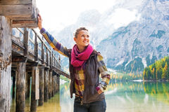 Woman on lake braies in south tyrol, italy Stock Photos