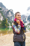 Woman on lake braies in south tyrol, italy Stock Images