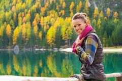Woman on lake braies in south tyrol, italy Stock Photo