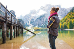 Woman at Lake Bries standing looking at wooden pier Stock Photo