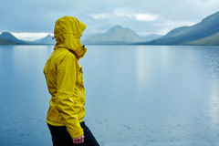 Woman on the Lake coast with mountain reflection, Iceland Stock Photography