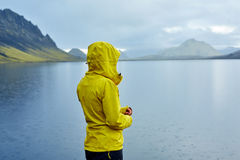 Woman on the Lake coast with mountain reflection, Iceland Royalty Free Stock Photography
