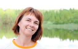 Woman at the lake Royalty Free Stock Image