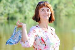 Woman at the lake Stock Image