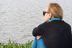 Woman on lake shore Royalty Free Stock Images