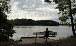 Woman by the lake Royalty Free Stock Image
