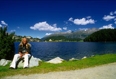 Woman by lake St. Moritz Royalty Free Stock Images