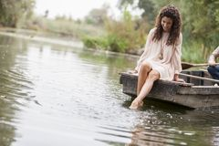 Woman on the lake. Young woman on the lake Stock Images