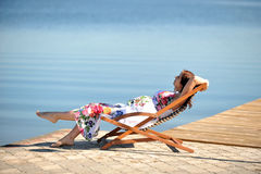 Woman on lakeside Stock Image