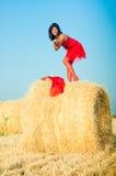 Woman on landckape near haystack Stock Photo