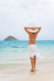 Woman lanikai beach. Woman in white sarong standing on beautiful lanikai beach in oahu, hawaii Stock Photos