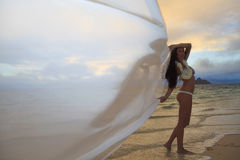Woman on lanikai beach at sunrise Stock Photo