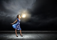 Woman with lantern Stock Photo