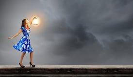 Woman with lantern Stock Image