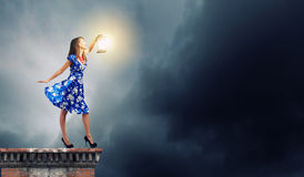 Woman with lantern Royalty Free Stock Photography