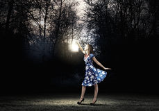 Woman with lantern Stock Images
