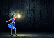 Woman with lantern Stock Image