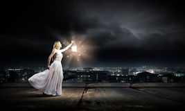 Woman with lantern Stock Photos