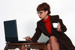 Woman with lap top and coffee Royalty Free Stock Photo