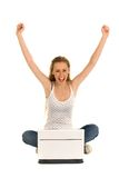Woman with laptop. Woman sitting with arms raised Stock Images
