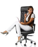 Woman with laptop. The attractive young woman with the laptop sits in an armchair on a white background Stock Images