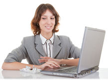 Woman and laptop. Business woman  in spectacles and laptop on white Stock Photography