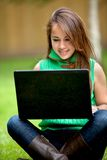 Woman on a laptop Stock Images