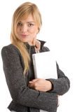 Woman with laptop. Portrait of young businesswoman holding laptop computer isolated on white background Royalty Free Stock Photos
