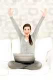 Woman with laptop. Woman holding laptop with arms raised Royalty Free Stock Images