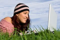 Woman on laptop royalty free stock images